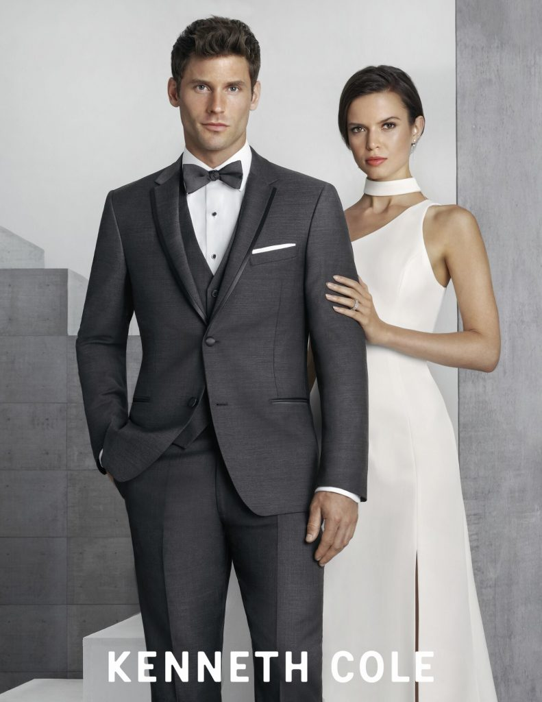Woman in white dress, man in grey suit